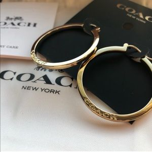 Coach gold earrings